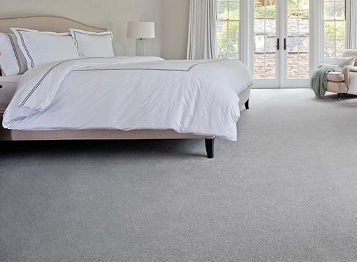 Bedroom scene with light gray carpet